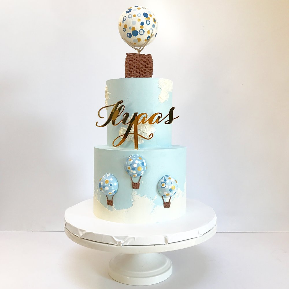 Baby boy's hot air balloon themed two tier buttercream 1st birthday cake.JPG