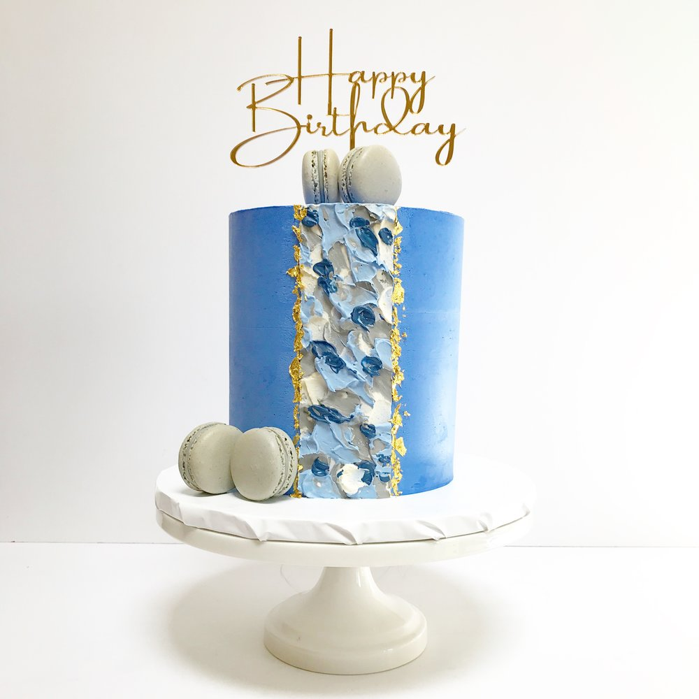 Blue birthday cake with textured buttercream and grey macarons.JPG