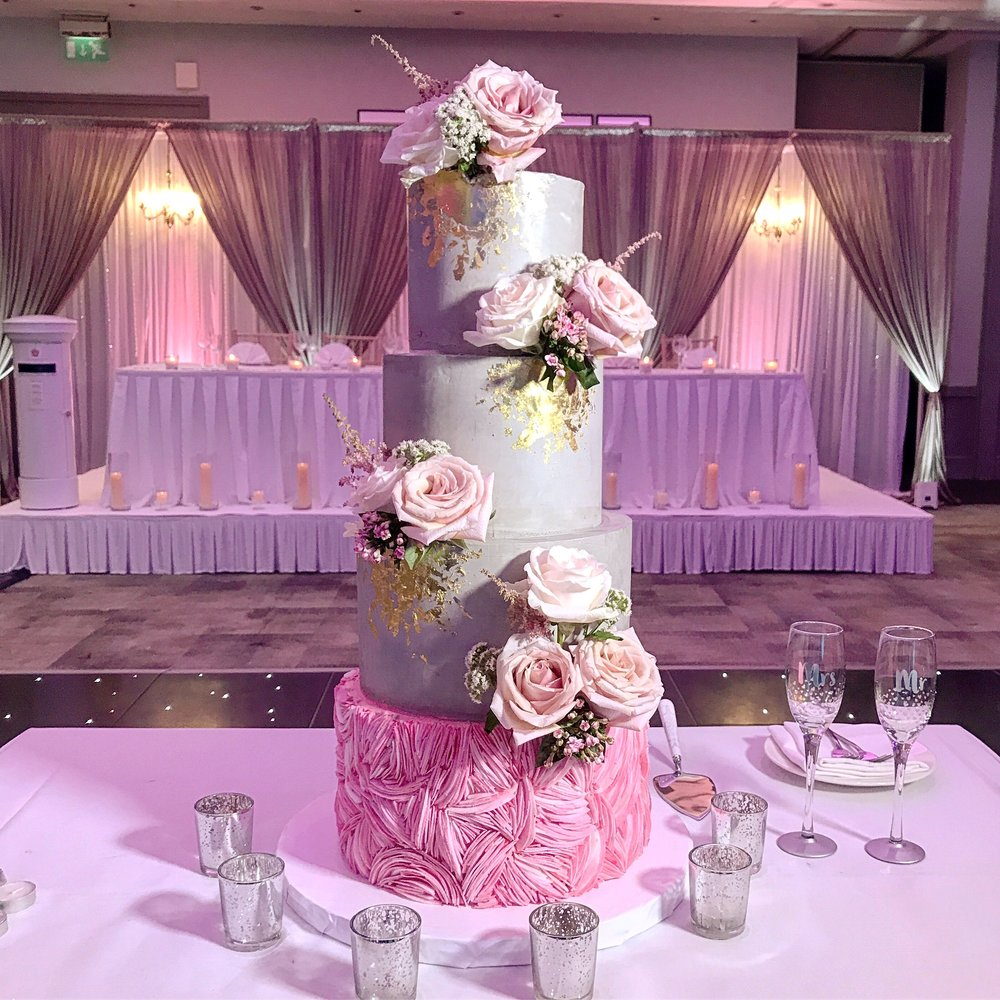 Grey and pink coconut ruffles four tier wedding cake.JPG