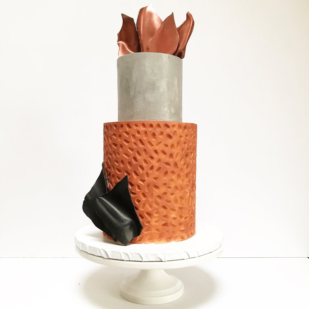 Copper and concrete two tier buttercream cake.jpeg