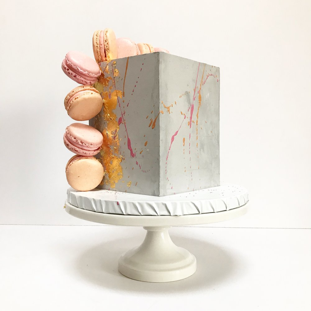 Concrete cube cake with macarons.jpeg