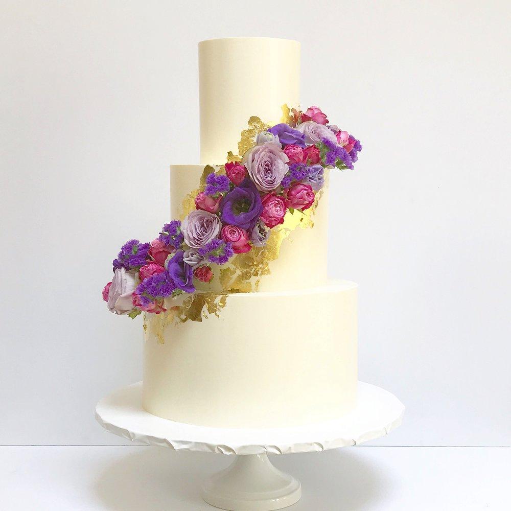 Purple, magenta and gold three tier wedding cake.jpeg