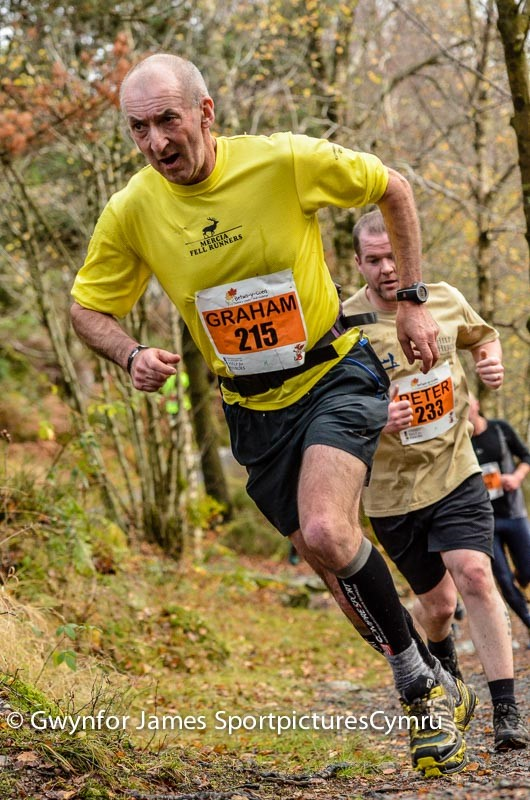 Man races to the top on the hill at Llyn Elsi