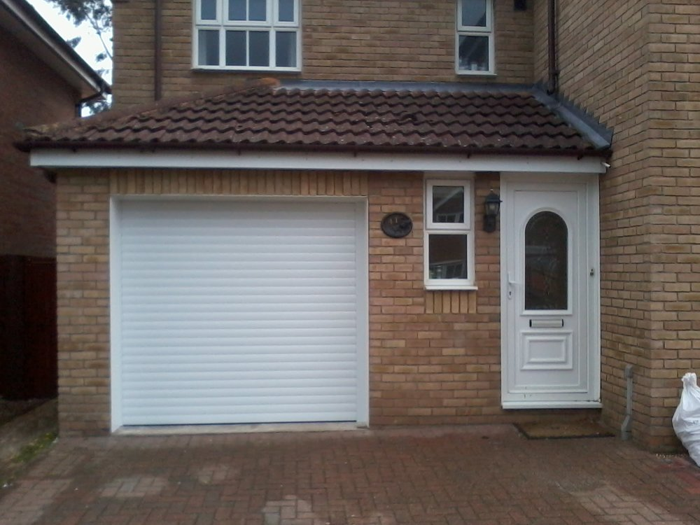 Benefits of a replacement garage door.  - A new garage door not only looks great but also provides a range of security features to help keep your valuables safe. Our bespoke range of garage doors can be made to measure meaning that we can fit almost any opening.
