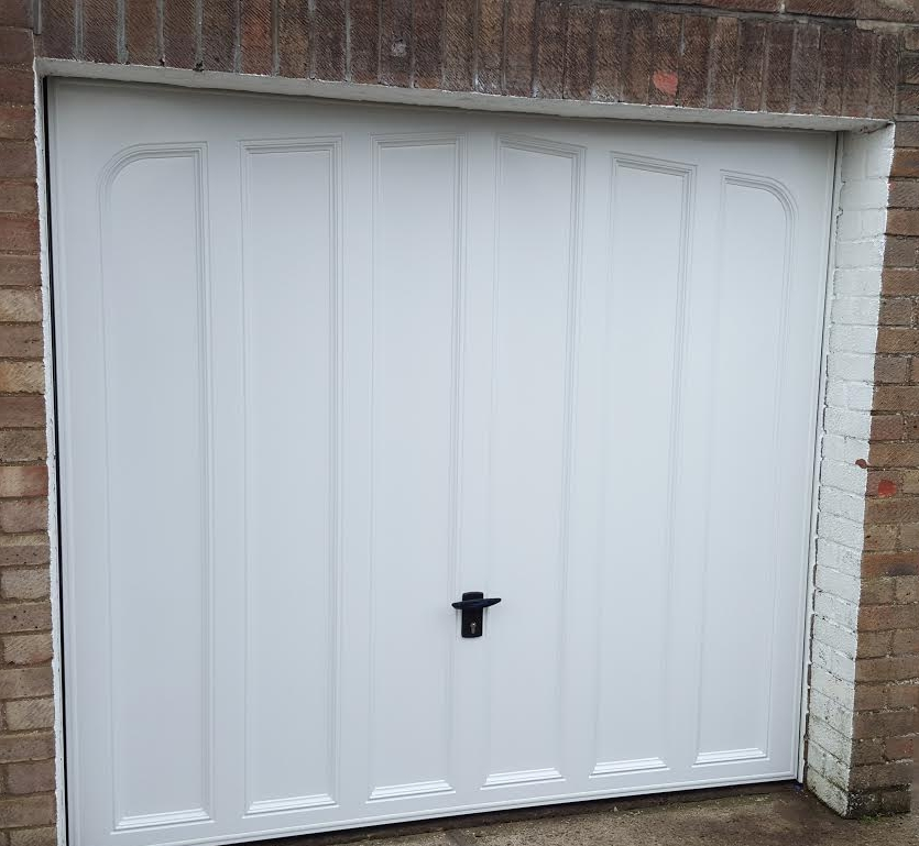 Up and Over Garage Doors - Up and over garage doors are a great choice for most garages and there are a range of style and colour options available. We supply and fit up and over garage doors in two materials; a strong, secure, lightweight steel and a robust plastic material designed to pop back into shape in the event of a dent.