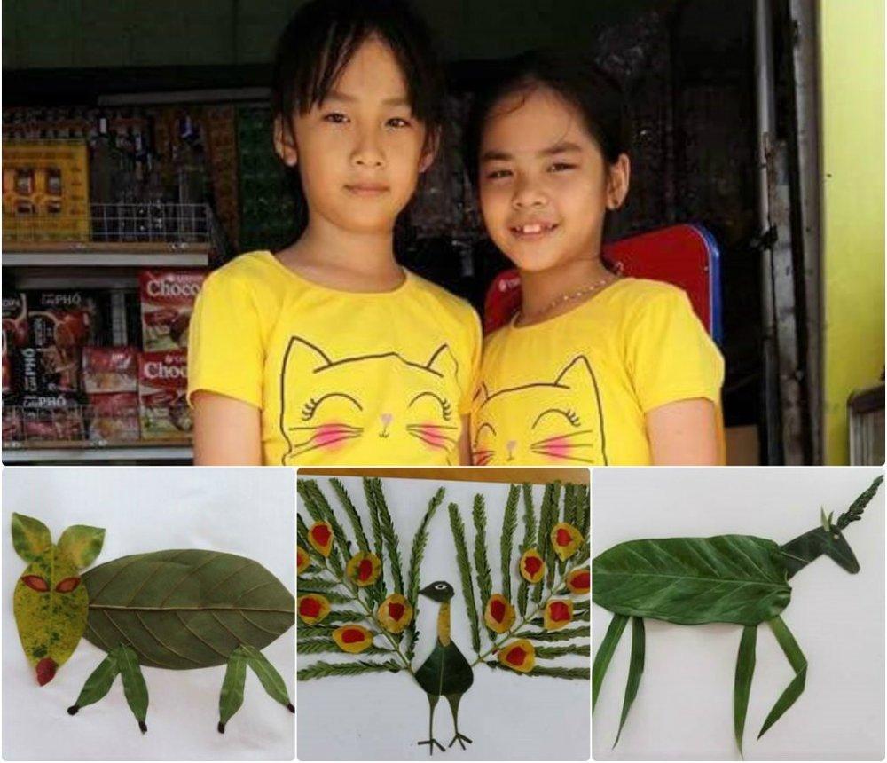 Bùi Nguyễn Thùy Vân (trái) và Phạm Ngọc Ánh (học sinh Trường Tiểu học Bình Hòa, thị xã Thuận An, tỉnh Bình Dương) cùng các sản phẩm trong album thế giới động vật ngộ nghĩnh từ lá cây của mình.