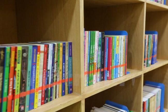 Dự án sẽ đem đến nguồn cảm hứng về văn hóa đọc dành cho thiếu nhi với kho tài nguyên sách vô cùng phong phú với hàng trăm đầu sách khác nhau, được trình bày bằng 3 ngôn ngữ: Anh, Việt, Hàn. (Ảnh: Minh Sơn/Vietnam+)