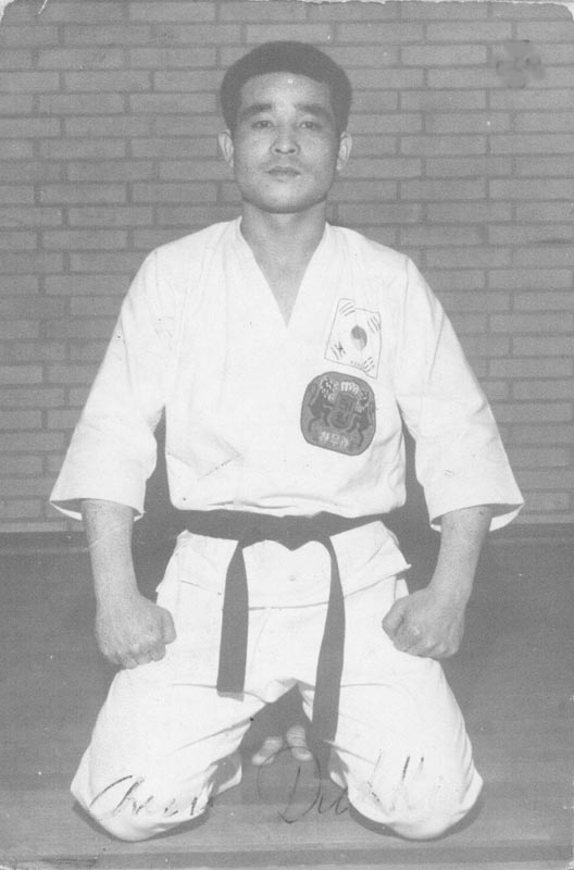 Chun Duk Ki poses at his Salisbury school; note the CMK patch.