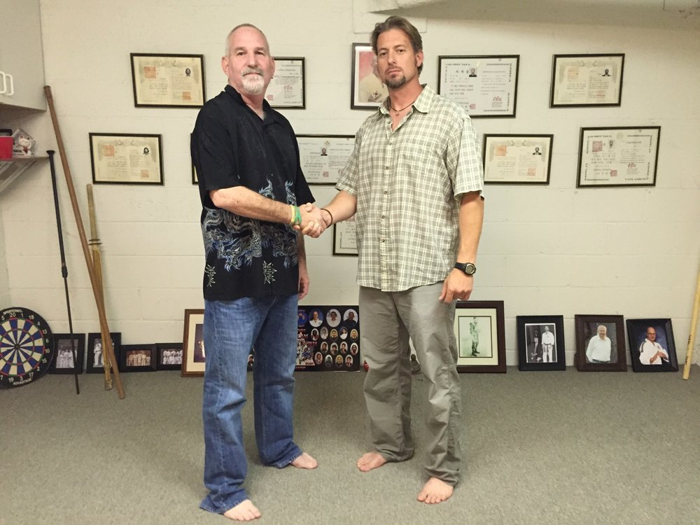 Jon Wiedenman, 9th Dan, promotes Jesse Boyd to 6th Dan in his San Pedro dojo (2015)