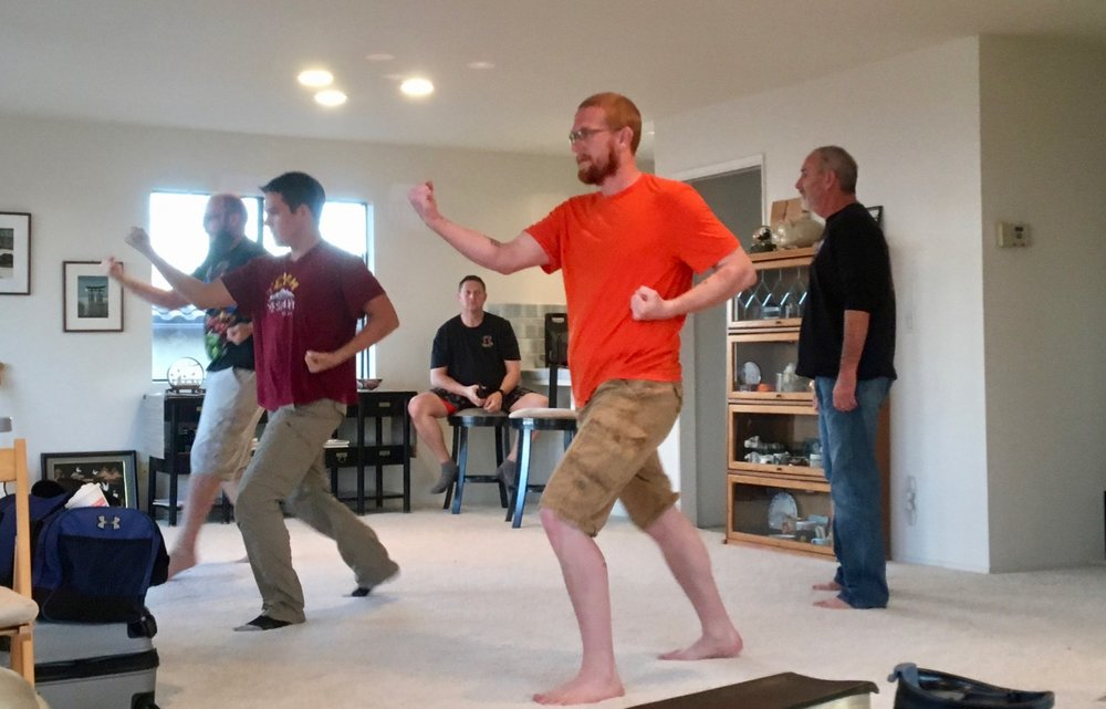CVMA Black Belts train with Jon Wiedenman in his San Pedro living room. Sensei Mike Arney observes.