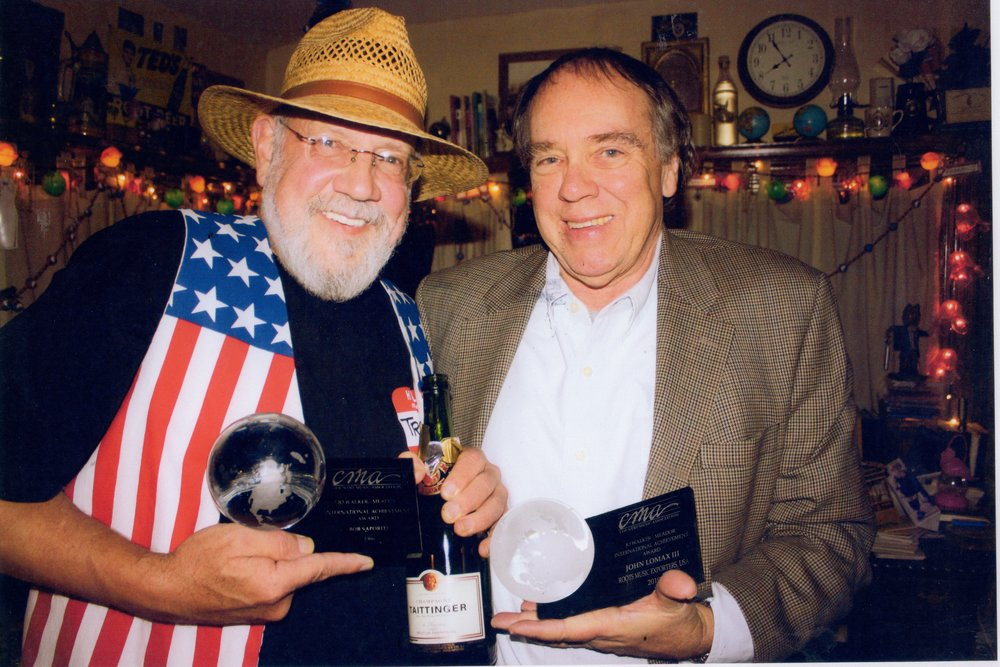 Bob Saporiti (aka Reckless Johnny Wales) and John compare their Jo Walker-Meador International Global Achievement Awards, 2010. Photo by Ryan Schemmel