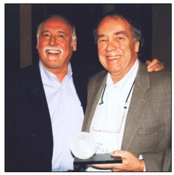 John Lomax III receving the Jo Walker-Meador International Award in 2010. Pictured with Steve Moore, Country Music Association CEO at the time.