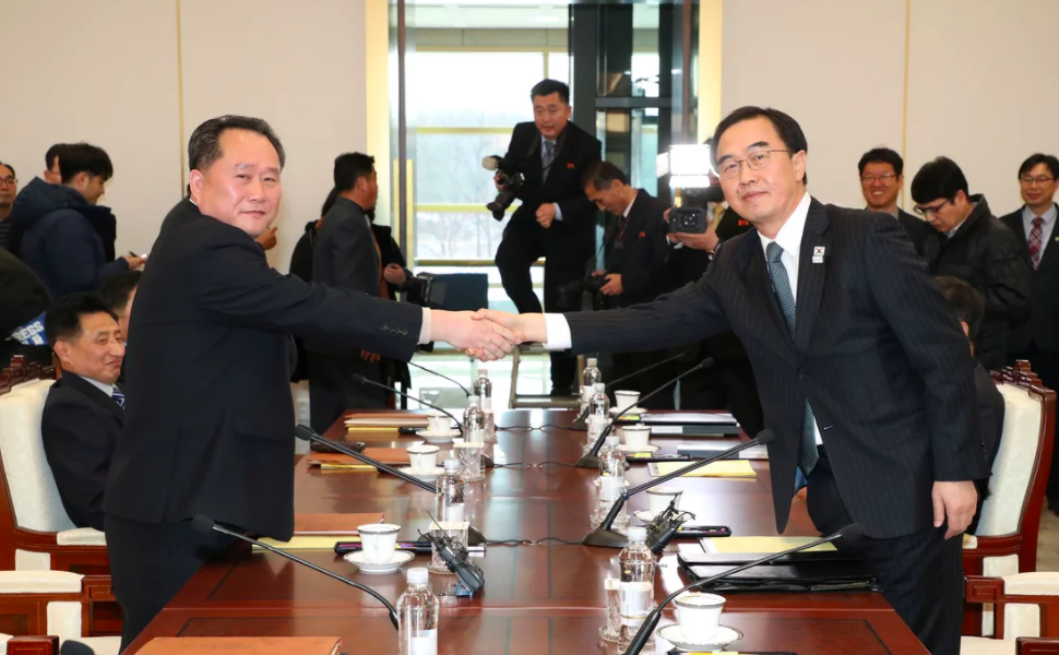 Head of the North Korean delegation Ri Son Gwon shakes hands with his South Korean counterpart Cho Myoung-gyon at the truce village of Panmunjom in the demilitarized zone in South Korea on Jan. 9, 2018, image courtesy of  Fortune