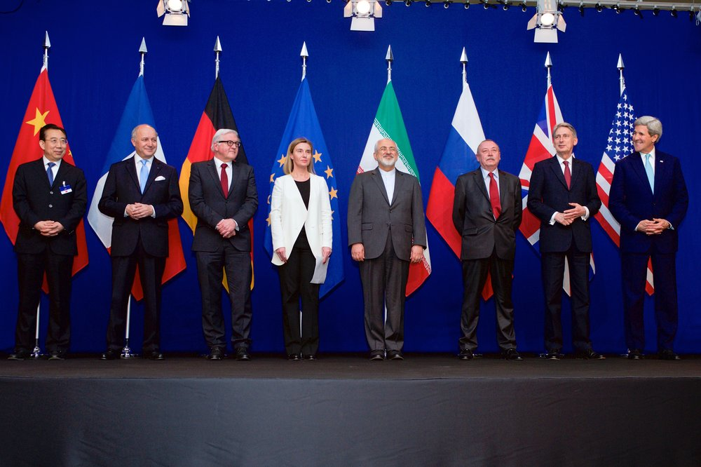 """Hailong Wu of China, Laurent Fabius of France, Frank-Walter Steinmeier of Germany, Federica Mogherini of the European Union, Javad Zarif of Iran, an unidentified official of Russia, Philip Hammond of the United Kingdom and John Kerry of the United States in the """"Forum Rolex"""" auditorium, Switzerland. Discussing Iran Nuclear Deal."""