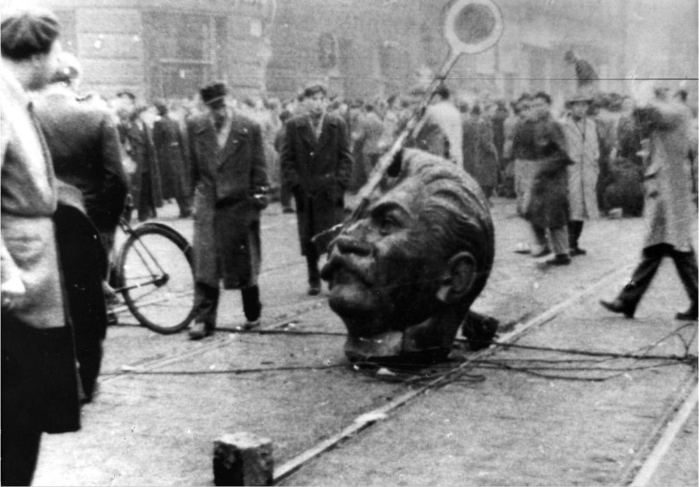 The head of a destroyed statue of Joseph Stalin lies in the middle of a Budapest Street during the Hungarian Revolution of 1956   Image Credit: Gabor B. Racz, Wikimedia Commons