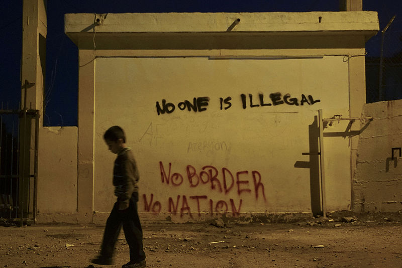 Graffiti at a refugee camp on the Greek Island of Lesbos   Image Source:    Wikimedia Commons,    User: Mstyslav Chernov