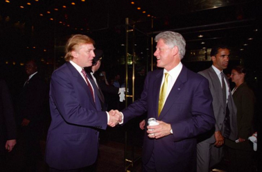 Trump and Clinton shaking hands in the 1990s