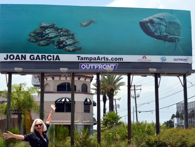 "Judge Joan Garcia with her ""Tampa Bay Tarpon"" on an Artpop billboard."