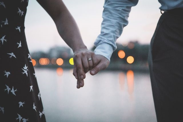 Connect with your husband again. Married couple holding hands by Brodie Vissesrs, used by permission from  FreeRangeStock . Need date night ideas for married couples? Keep reading!