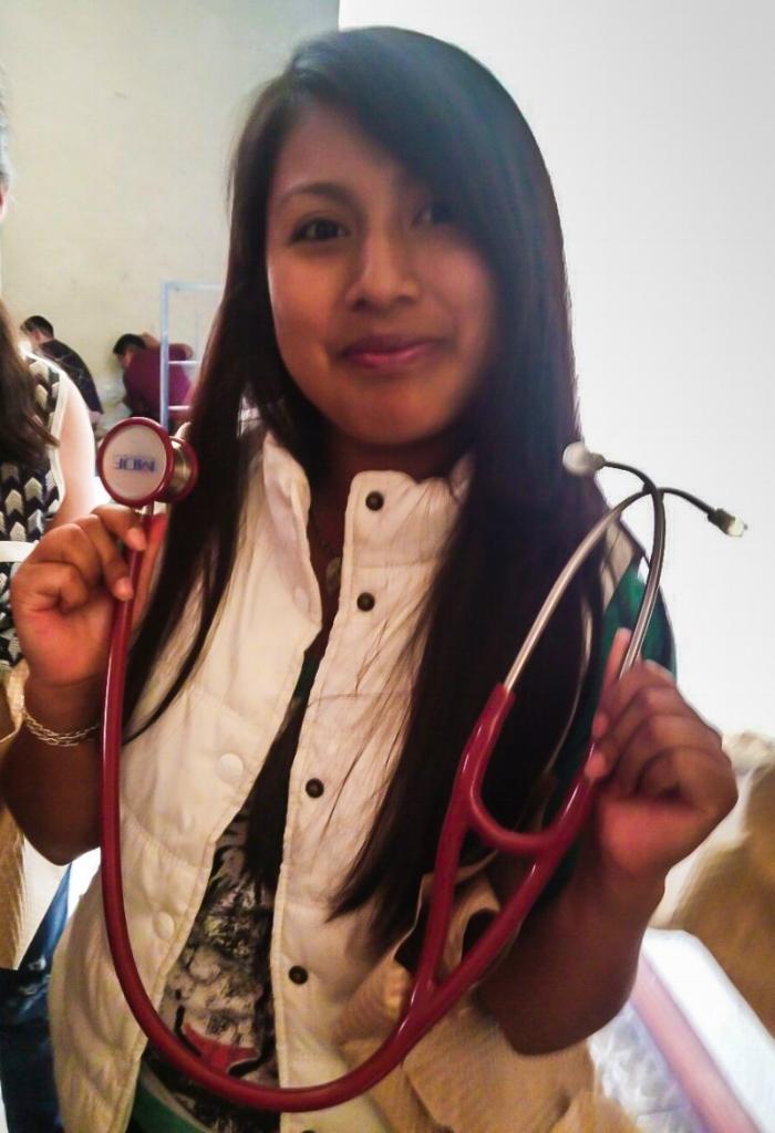 Student Gloria Marina receiving new stethoscope
