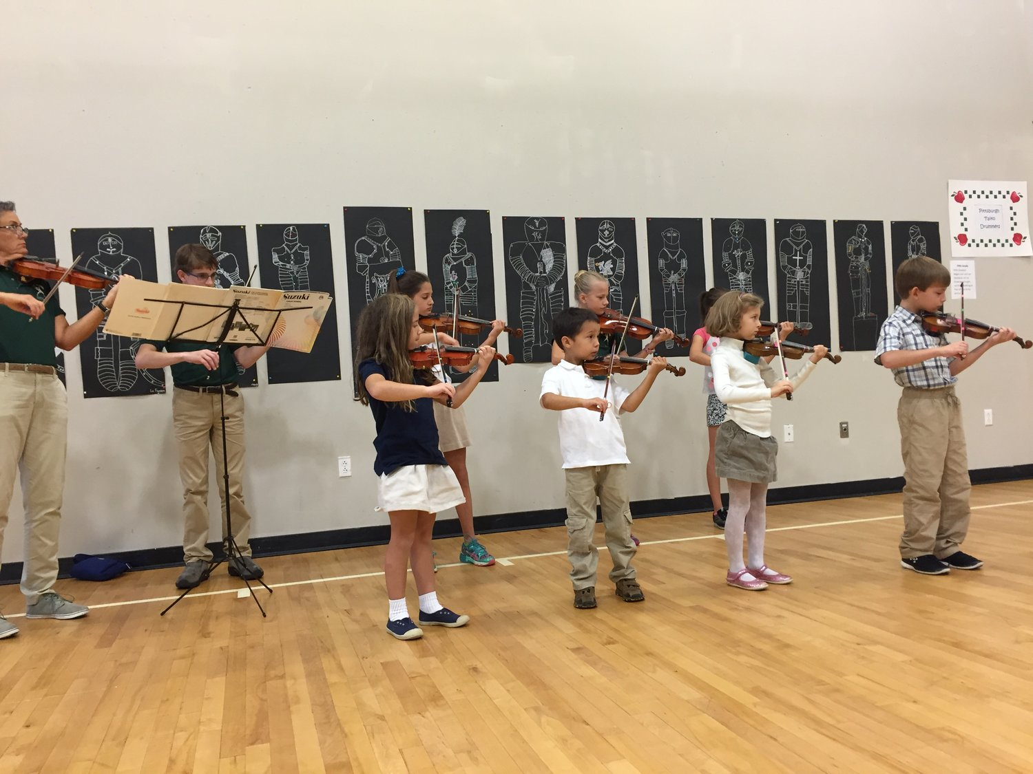 Ms. Leah and violinists perform at Winchester Thurston North School's Applefest