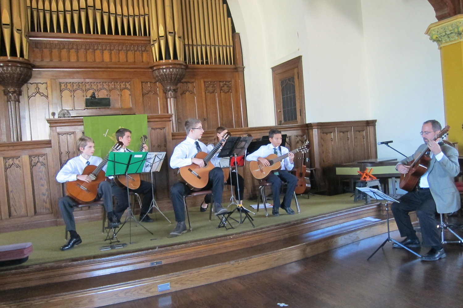Guitarists perform together at the Ensemble Recital