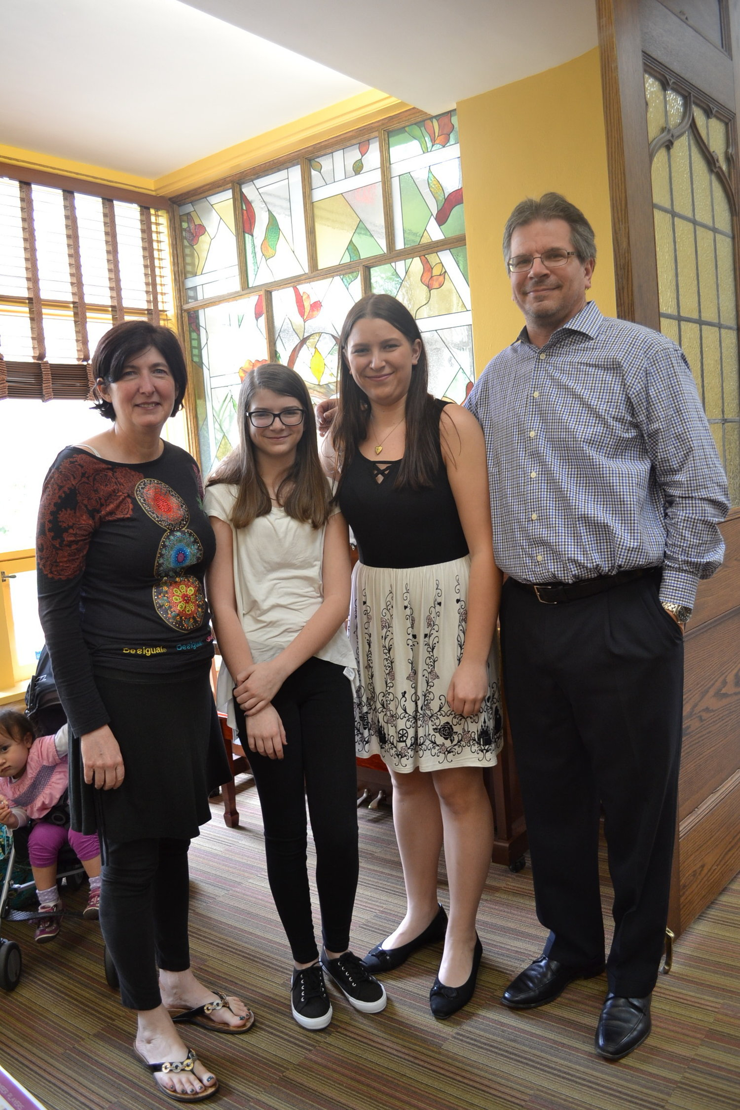 The Spear family celebrates Allison's graduation from CYM at the Solo Recital