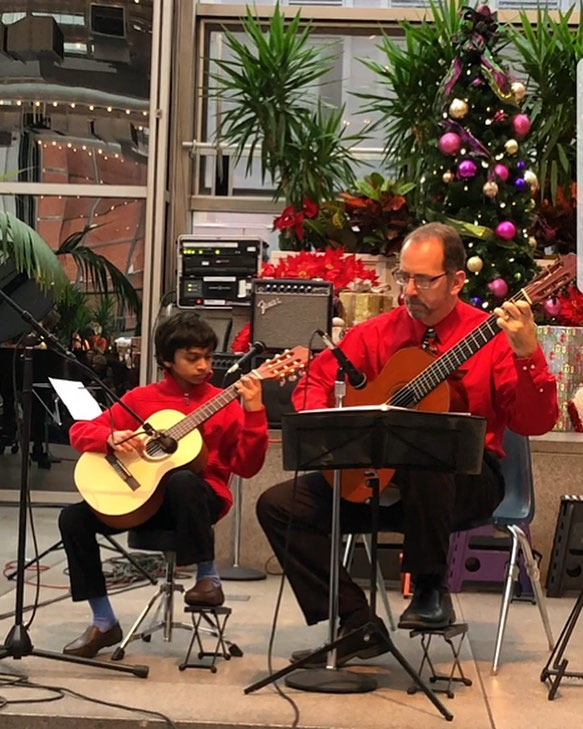 Last Saturday, CYM students entertained ice skaters!  Guitar and piano students performed festive music for the families at PPG Wintergarden, creating an atmosphere of holiday cheer.  It's amazing how professionally our young musicians conduct themselves in public settings!