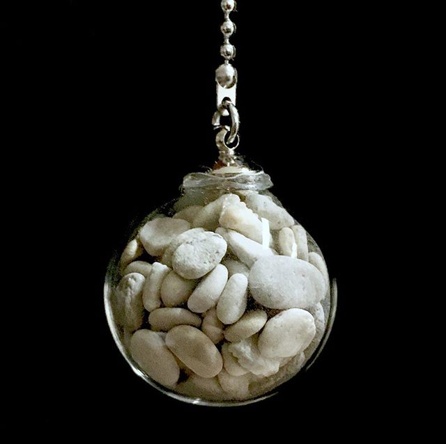 """Mere Objects: tiny white stones collected from the shore of Lake Michigan. These were sent by a woman who references Revelation 2:17 """"Whoever has ears, let them hear what the Spirit says to the churches. To the one who is victorious, I will give some of the hidden manna. I will also give that person a white stone with a new name written on it, known only to the one who receives it."""" She goes on to write:  A desire to find the right one The white stone that bears my unknown name The new name given when this world is past All wrongs are right and all is made new  A bright, smooth, white one found, too big Unable to be part of the whole Artistic sharing created by hands An expression of pain and glory  Journey on to find many stones Small enough to be a part of it Each represents a person, a story  Of unspeakable grief and courage  Tiny light stones among others That were bigger therefore excluded  The small, broken ones, often overlooked  Patiently worn smooth by sand and waves  Each one holds a story like mine Horrific, forever life changing Beautiful, grace-filled, deeply redeeming  Many stones, overwhelming mercy  One day we will all stand together  In glory before the Designer  To each perfected one, a sacred stone To know and to become our true name  Victorious one, may divine comfort and healing be as solid as these ancient stones, now in the present and in the world to come. ❤️ *** Please feel free to leave this person a message of support or solidarity in the comments below. ***"""