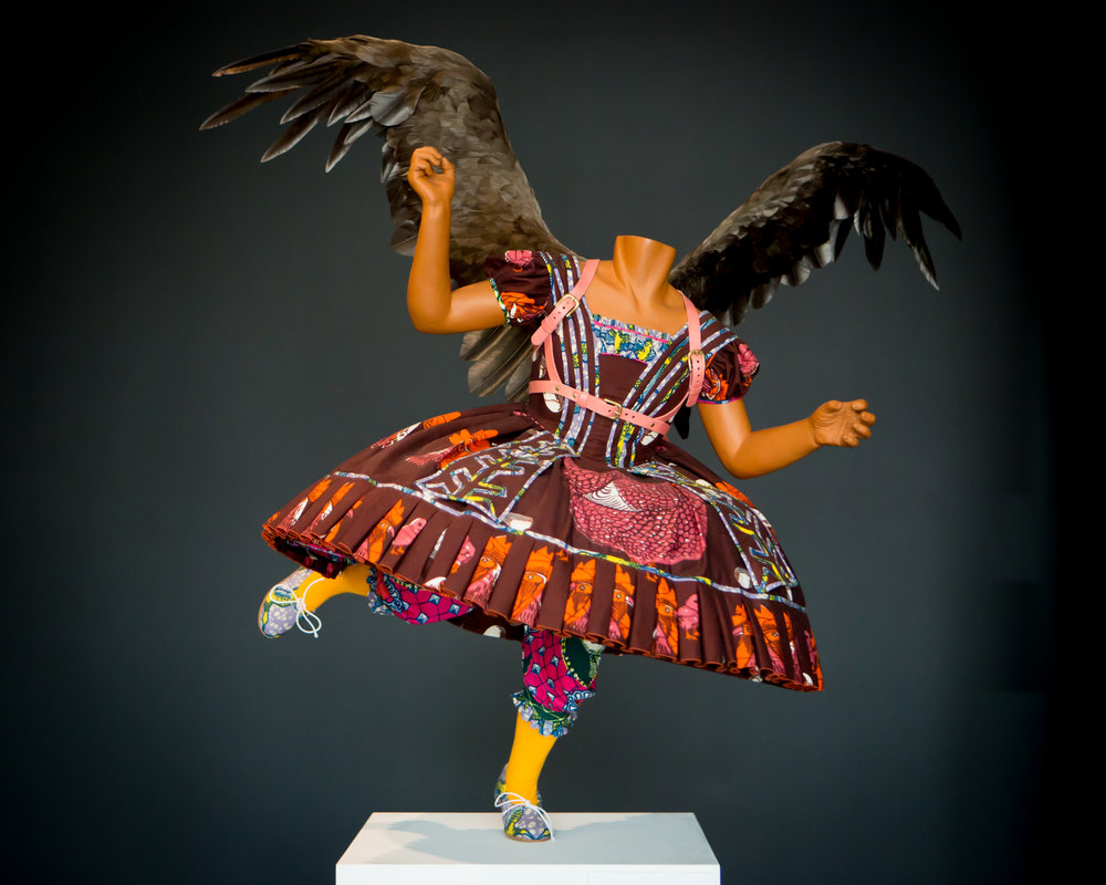 "Yinka Shonibare.    Food Faerie  , 2010, Mixed media: mannikin, Dutch wax 46.47 x 47.25 x 38.13"" (118.03 x 120.02 x 96.85 cm) Gift of Richard Cohen, August 2012 The Cooper Gallery Permanent Collection"