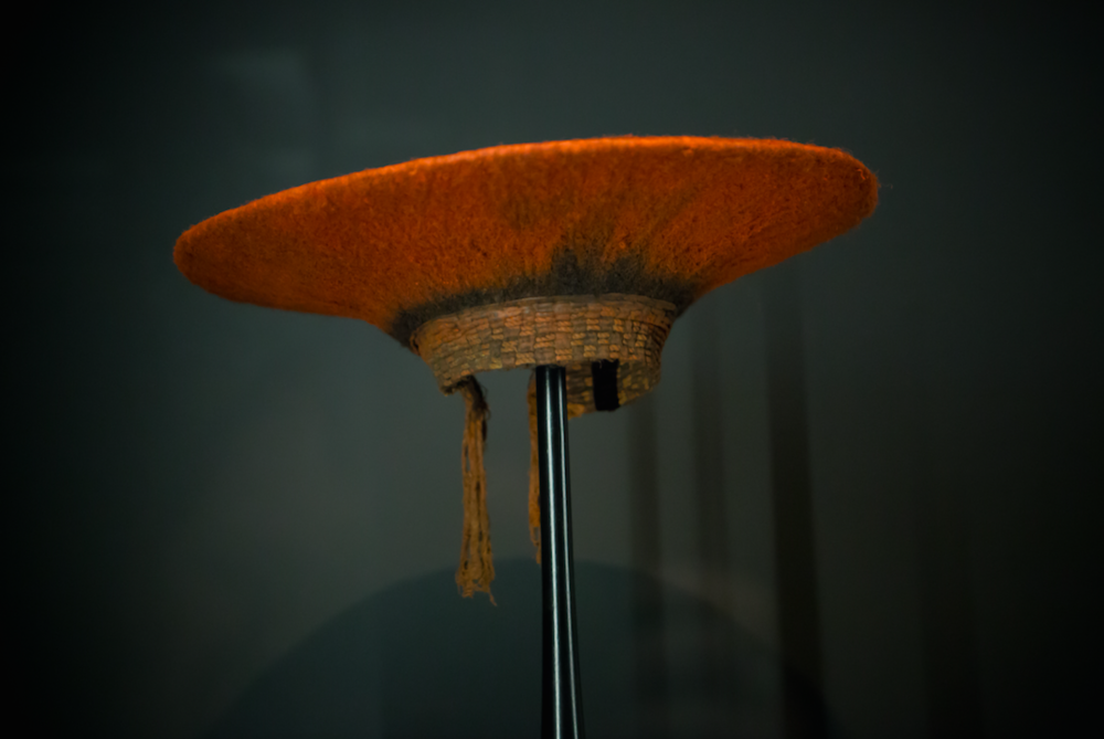 "South Africa, Zulu Hat,  ca. 1950s Fabric, human hair, red pigment Width: 18"" (46 cm) The Cooper Gallery Permanent Collection"
