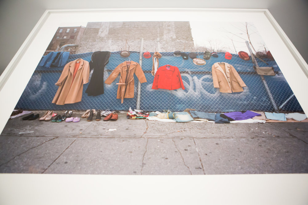 "Dawoud Bey  (b. 1953)   Clothes and Bag for Sale  (from Harlem Redux)  2016 Archival Pigment Photograph. 40 x 48 "" (101.6 x 121.9 cm) Image © Dawoud Bey, Courtesy of Stephen Daiter Gallery"