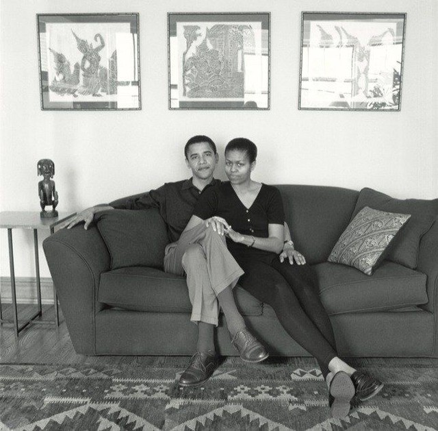 "The Cooper Gallery would like to wish you a warm Valentine's Day on this cold February morning! ⠀ ⠀ As a part of a series on American Couples, fine-art photographer Mariana Cook captured this intimate portrait of Barack and Michelle Obama posed in their home in Hyde Park in 1996. During this interview with the 'Chicago Couple,' Michelle discusses the possibility of Barack's involvement in politics and how this will shape their both of their growing careers and family. ""Barack has helped me loosen up and feel comfortable with taking risks, not doing things the traditional way and sort of testing it out, because that is how he grew up,"" comments Michelle on their different approaches to life influenced by their childhood experiences. Continuing on the conversation and responding to his wife's remarks, Barack states ""It's that tension between familiarity and mystery that makes for something strong, because, even as you build a life of trust and comfort and mutual support, you retain some sense of surprise or wonder about the other person.""⠀ ⠀ Image Description: Mariana Cook. ""A Chicago Couple (Barack and Michelle Obama). 1996. Selenium toned gelatin silver print. 11 1/4 x 10 7/16 in. Part of the Hutchins Center Permanent Collection."