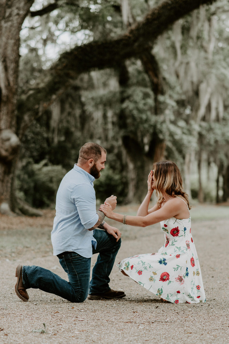 Sweet family and surprise proposal session in st. francisville, louisiana at rosedown plantation with gorgeous oak trees photographed by magnolia and grace photography