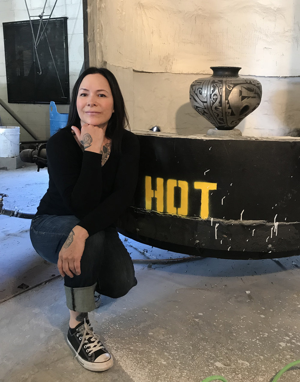 "Tammy posing with  ""When The West Was One""  in front of a kiln."