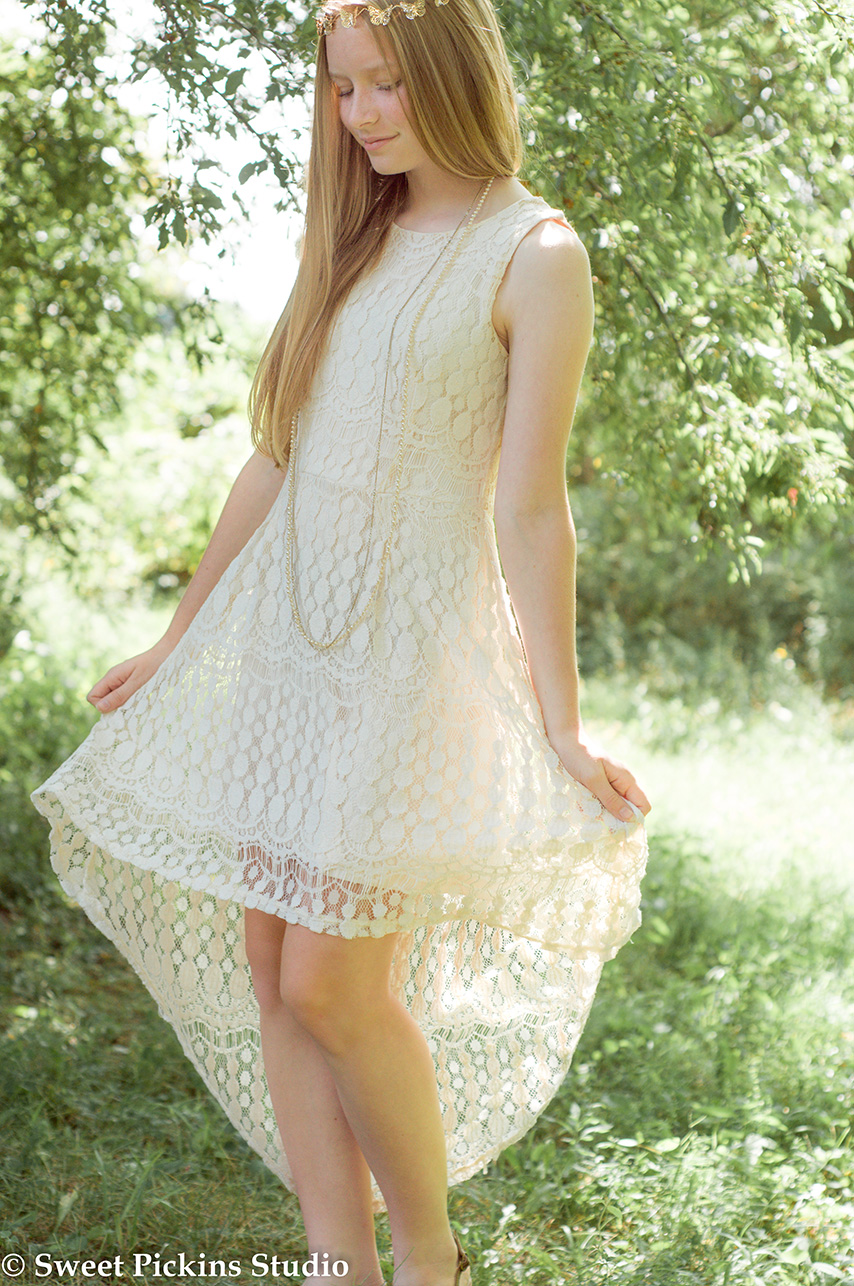 Teen photo session in cream lace dress in garden