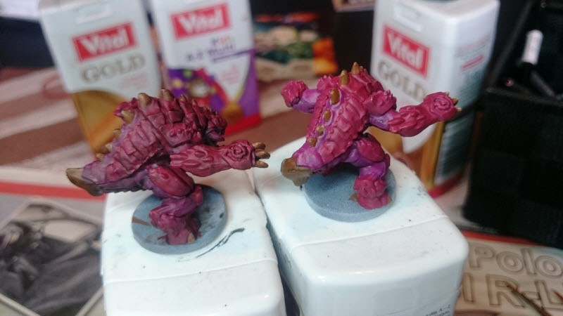 Pinky on the left has had the wash applied. You can see there is more depth to the details and they stand out better.