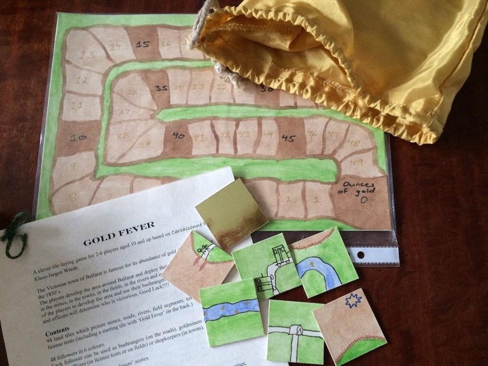 This is a rethemed, handmade version of Carcassonne that Phoebe created for a school project about the Australian gold rush when she was ~11.