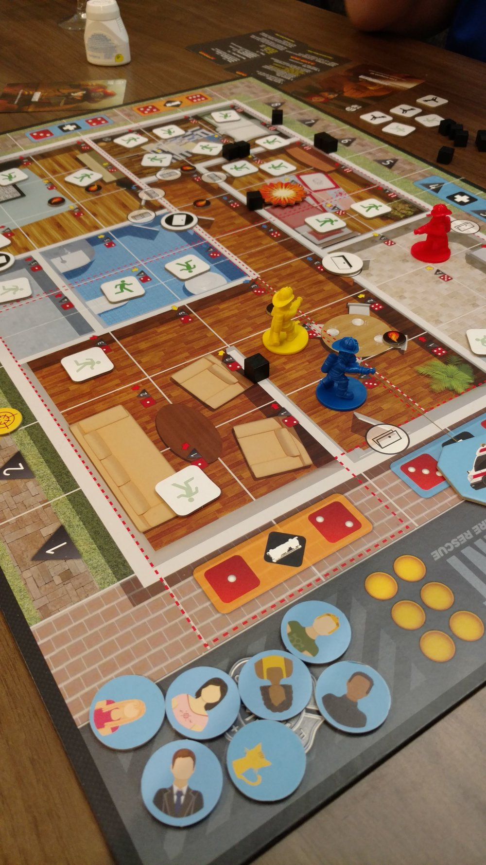 "6. Flash point Fire Rescue - I've played this several times this year. This particular game was during a break from a visit to check on my mom. My sister came to our hotel and I had brought up part of my set as a ""travel version"" - except I forgot the smoke tokens. The people walking tokens are our make shift smoke tokens. This was a nice break from our stressful time at the hospital."