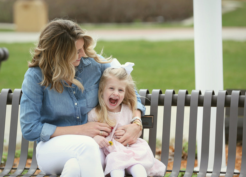 Fashion blogger, Lady and Red sitting on a park bench with daughter R | LadyandRed.com