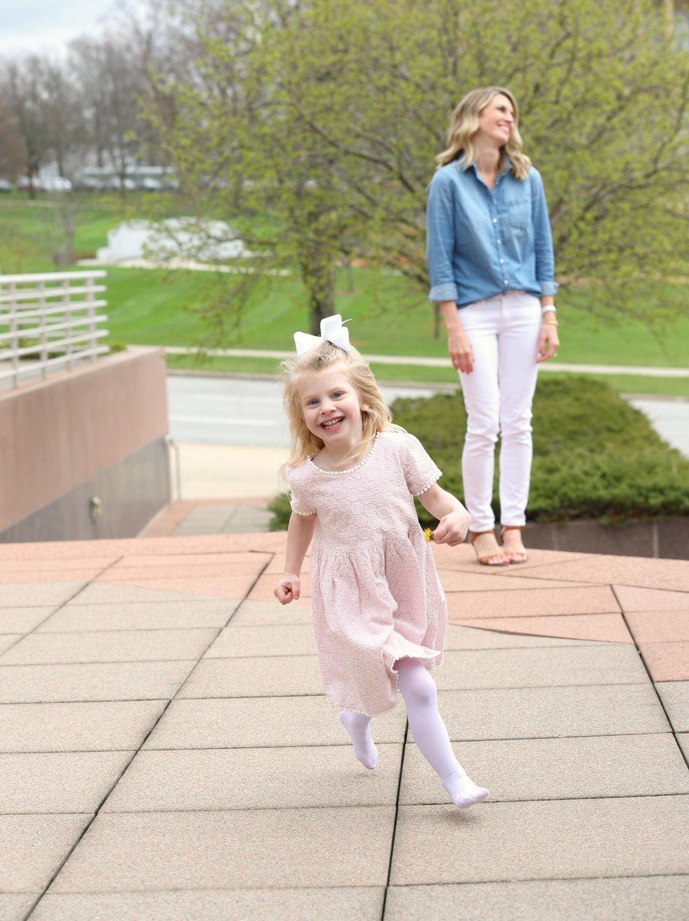 Fashion blogger, Lady and Red laughing in the background while daughter R runs during a photoshoot | LadyandRed.com