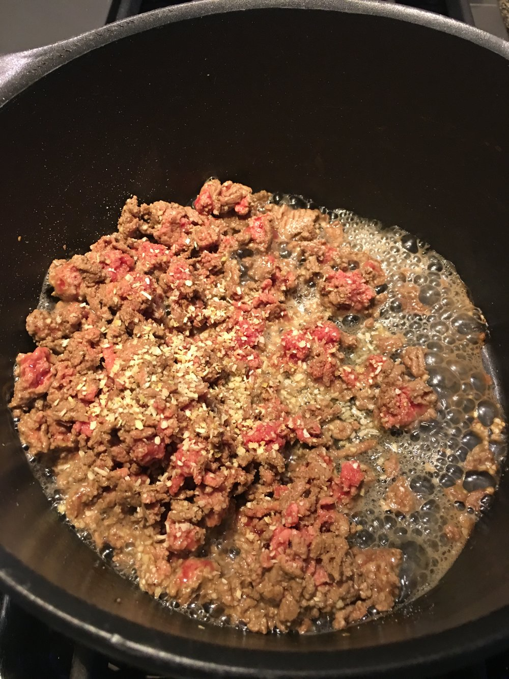 Ground beef being browned in a skillet