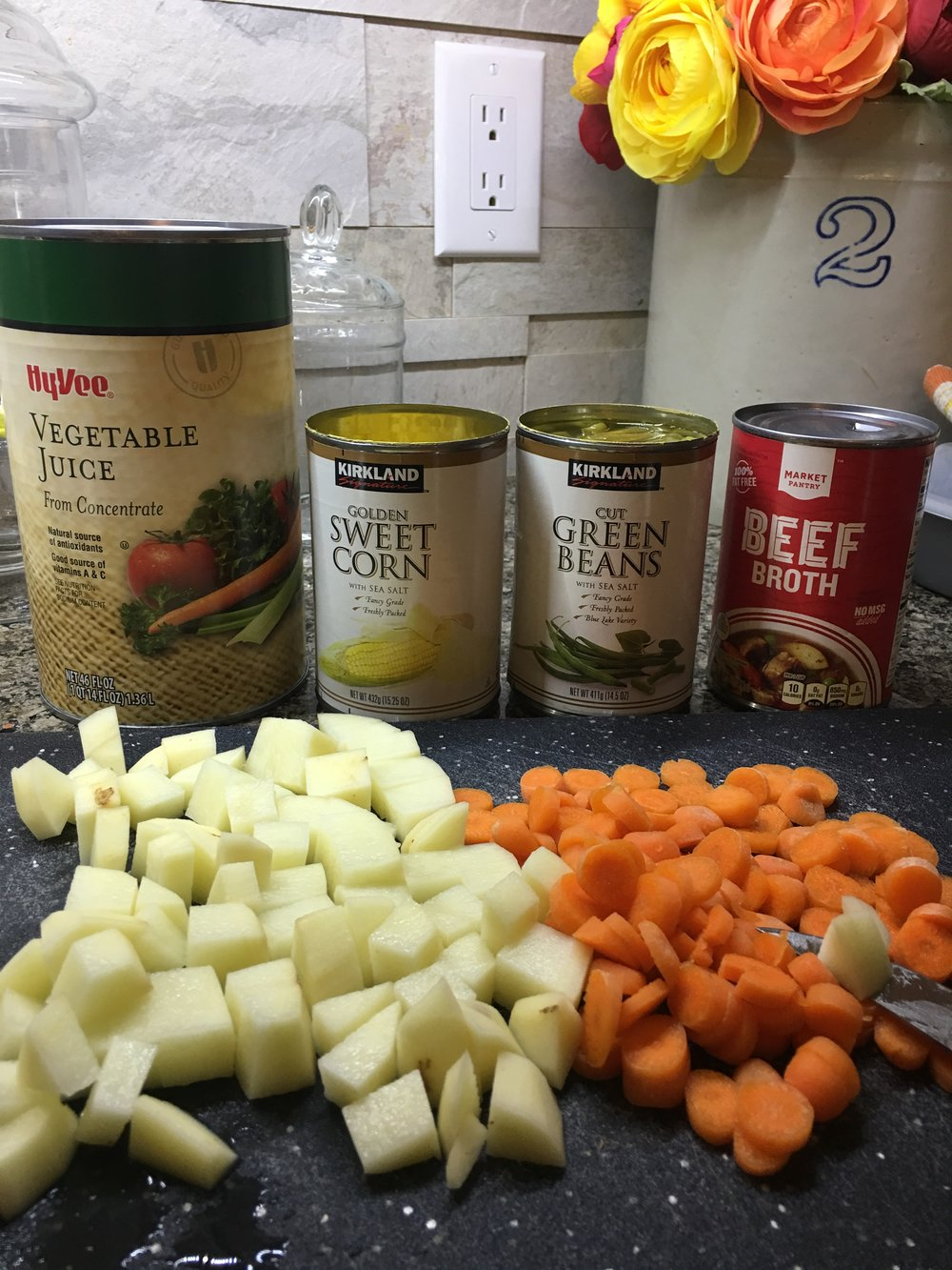 Canned vegetables, and diced fresh vegetables. Ingredients to make Vegetable Beef Soup