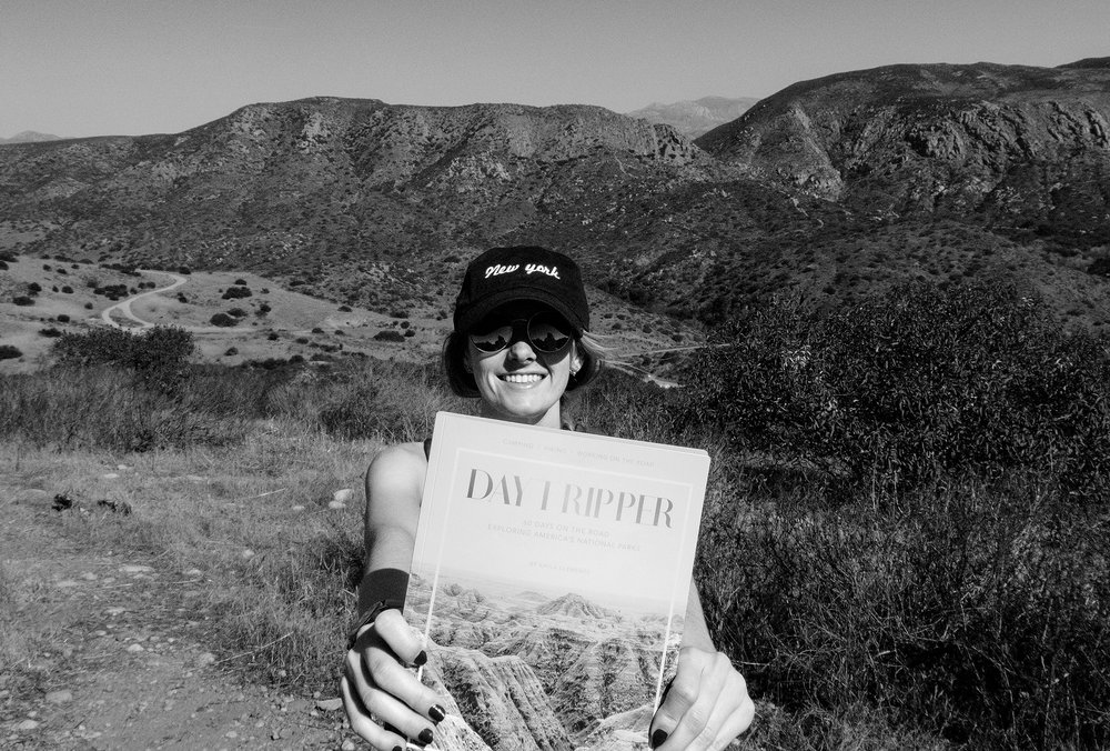 On a hike holding one of the first proofs of my book,   Daytripper: 60 Days on the Road Exploring America's National Parks  .