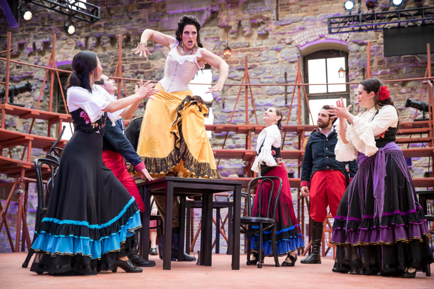"""Audrey Babcock as Carmen dances on the table in Mill City Summer Opera's """"Carmen."""" (Photo by Dan Norman)"""