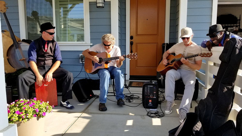 (l-r) Todd Szabo, Curt Brock, David Storrs, and Kingfish enjoying themselves and the music.