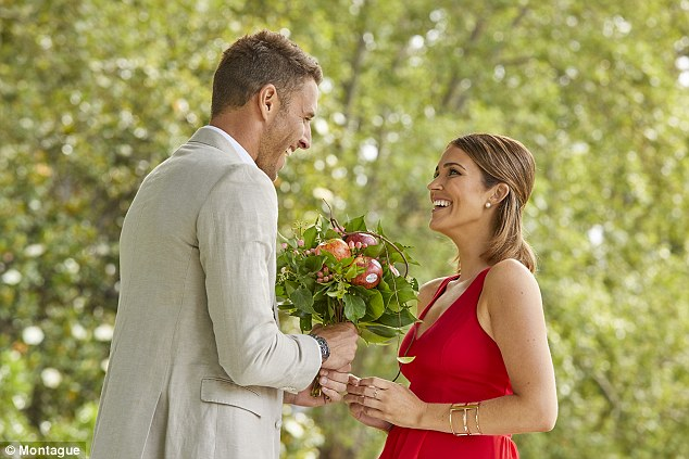 The apple of her eye: The Bachelorette lovers Georgia Love, 28, and Lee Elliott, 35 have starred in a cheesy Valentine's Day photo shoot to promote a range of love-themed apples.