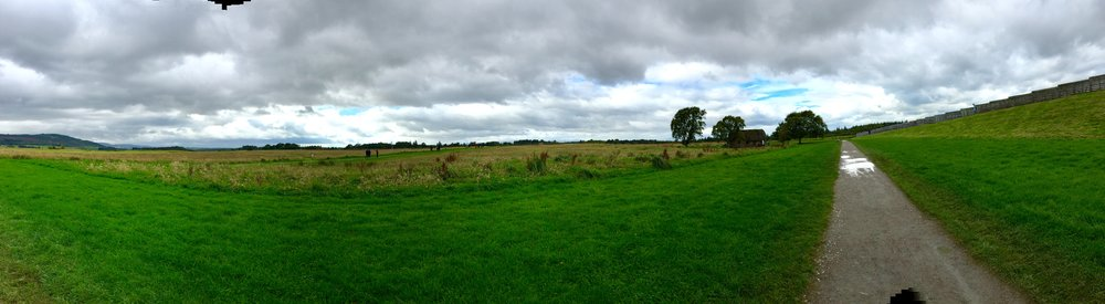 A panoramic view of the Culloden battlefield from Leanach Cottage on right across the moor to the edge of the visitor center at left.