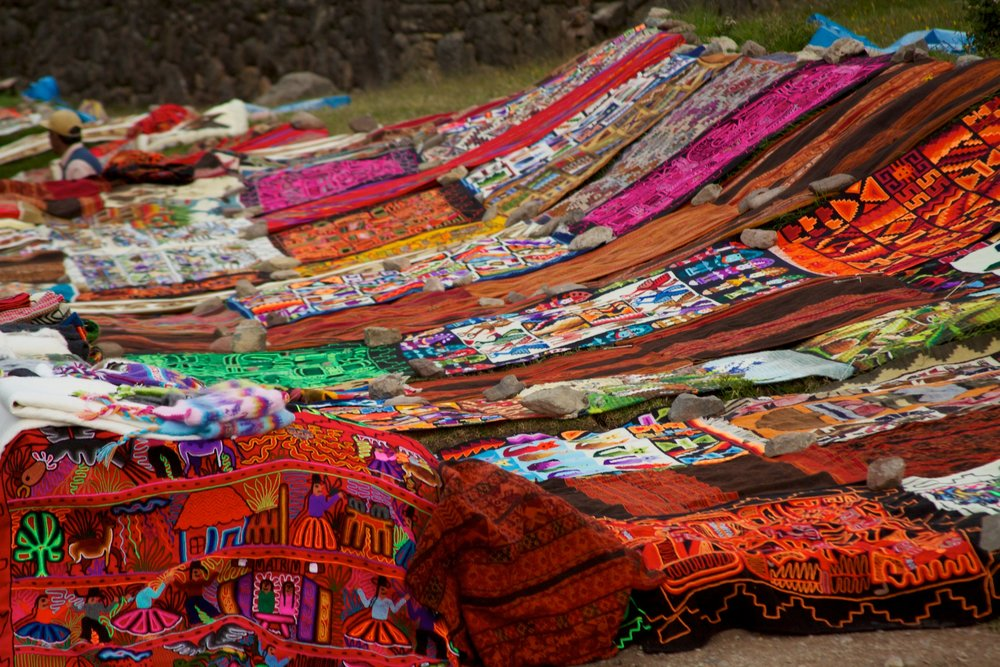 Peru_-_Cusco_Sacred_Valley_&_Incan_Ruins_039_-_textile_handcrafts_for_sale_at_Tambomachay_(7092596219).jpg