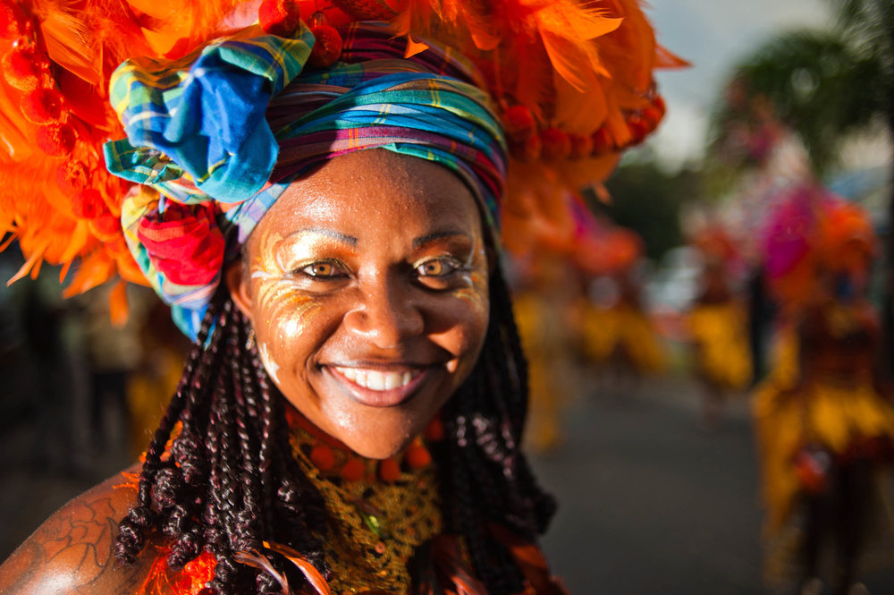 Guadeloupe_winter_carnival,_Pointe-à-Pitre_parade._A_young_woman,_performer_wearing_traditional_carnival_head-dress(close_up_outdoor_portrait).jpg